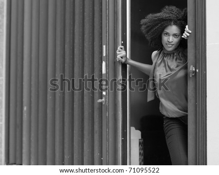 Woman in the doorway - stock photo