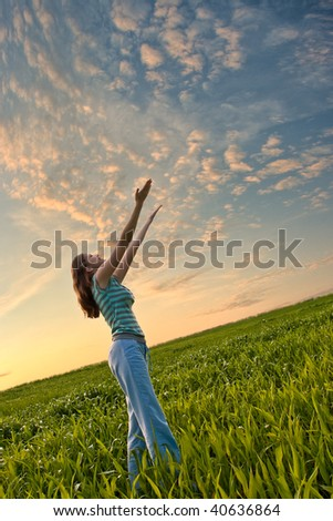 woman in the field during sunset