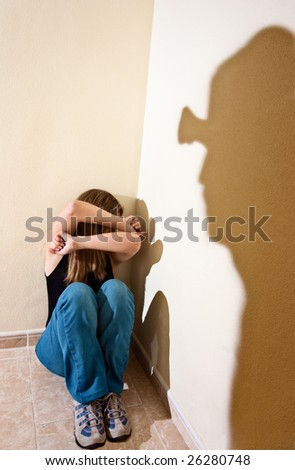 Woman in the floor suffering the violence of a man - stock photo