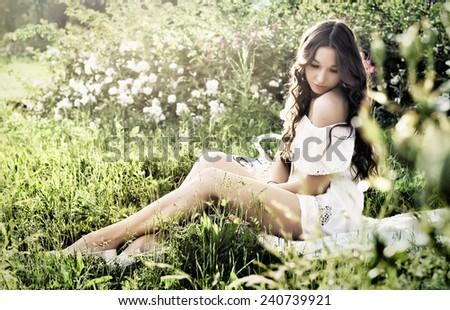 Woman in the garden - stock photo