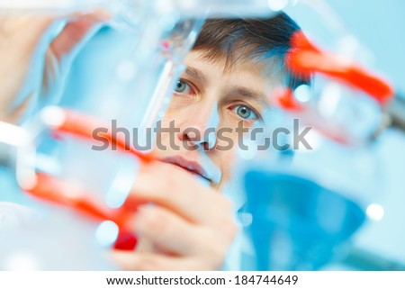 Woman in the microbiology laboratory - stock photo