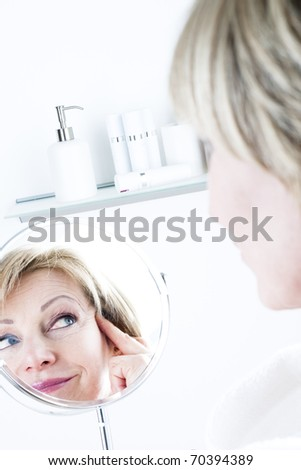 Woman In The Mirror - stock photo