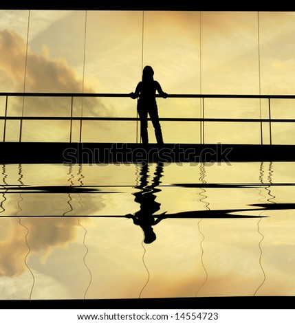 woman in the modern building at sunset - stock photo