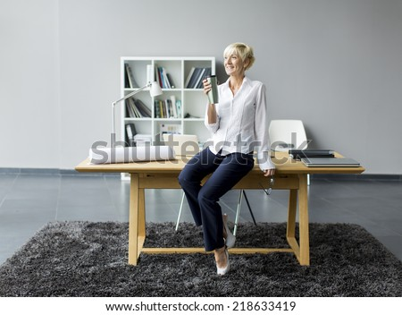 Woman in the office - stock photo