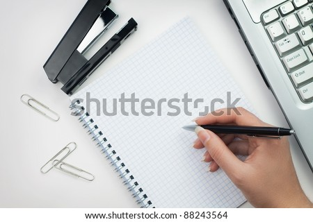 woman in the office ready to write - stock photo