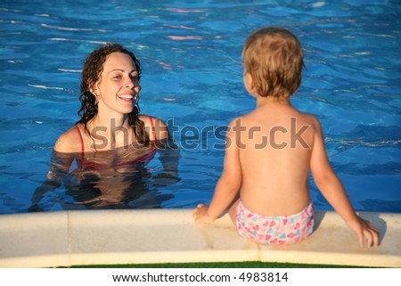 woman in the pond and the child - stock photo