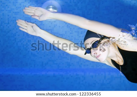 Woman in the pool - stock photo