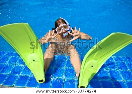 woman in the pool with fins and snorkel - stock photo