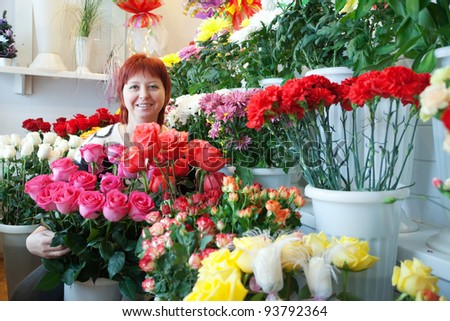 woman in the shop surrounded by different flowers