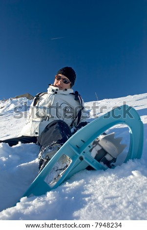 Woman in the snow with snowshoes