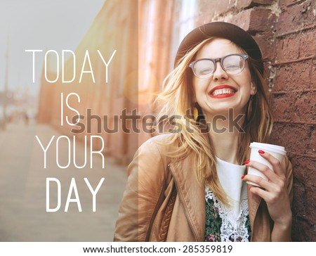 Woman in the street drinking morning coffee in sunshine light with motivational text