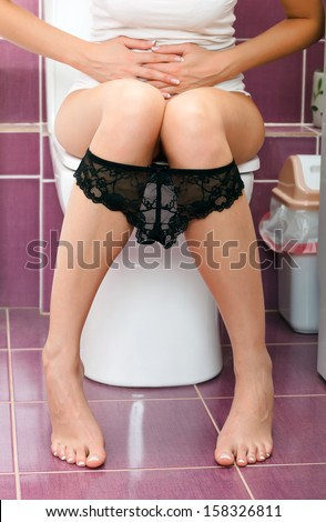 Woman in the toilet  - stock photo