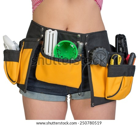 Woman in tool belt, close-up. Isolated on white background - stock photo