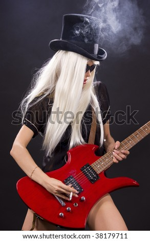 woman in top hat with red electric guitar and cigarette - stock photo