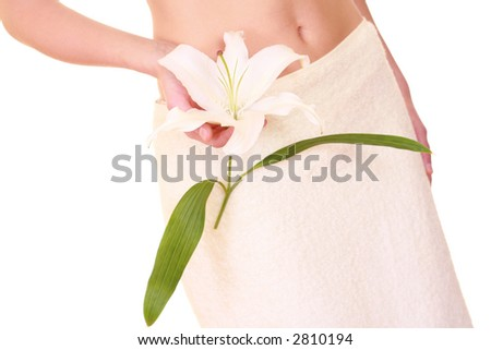 woman in towel with bottle of lotion isolated on white - body care - stock photo