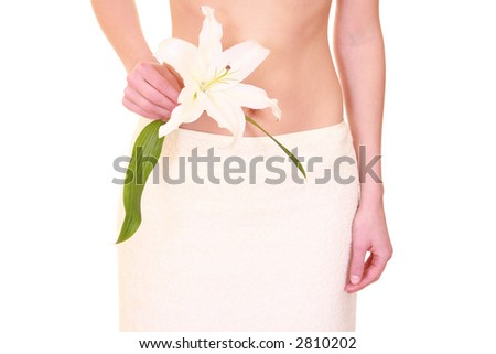 woman in towel with lily isolated on white - body care - stock photo