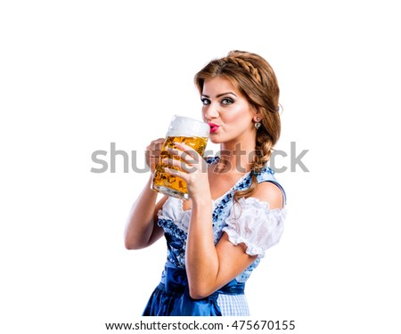 Woman in traditional bavarian dress drinking beer