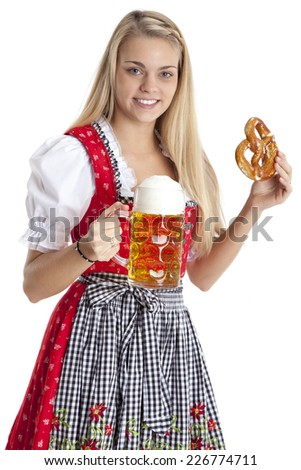 Woman in traditional costume with beer and pretzel.