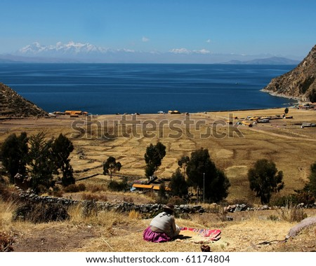 woman in traditional dress on titicaca lake in bolivia - stock photo