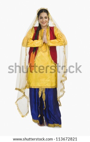 Woman in traditional Punjabi dress greeting - stock photo