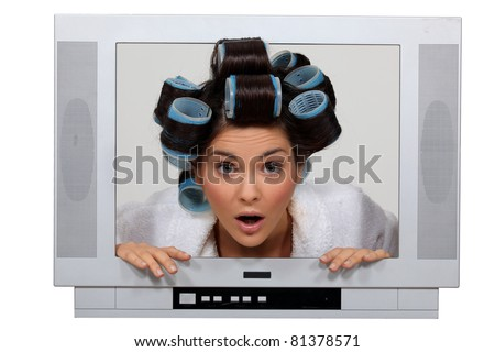 woman in tv set with hair curlers - stock photo