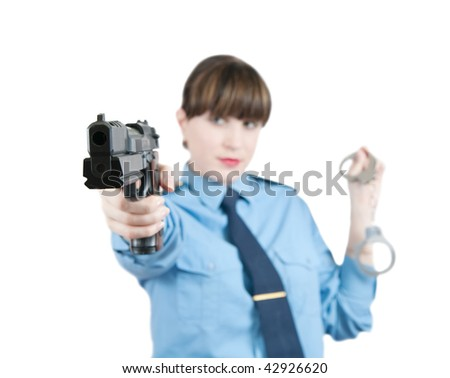 woman in uniform with gun and manacles over white, Focus on gau only - stock photo