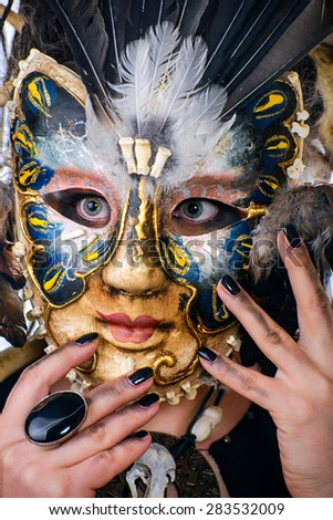 Woman in Venetian mask - stock photo