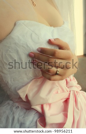 Woman in wedding dress, wedding ring on his hand - stock photo