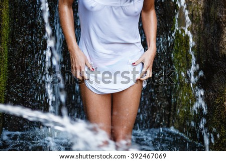 Woman in wet dress. - stock photo