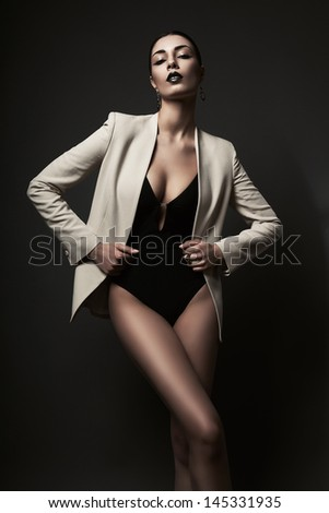 woman in white blazer and black body - stock photo