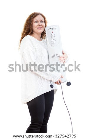 Woman in white blouse holding oil heater in hands  Isolated on white background - stock photo