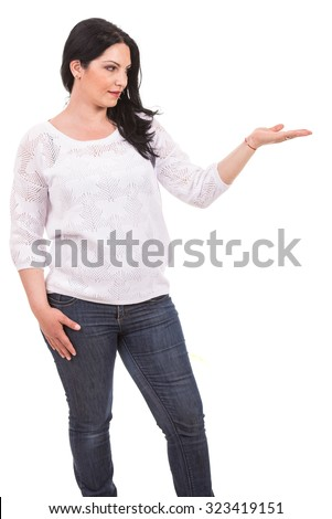 Woman in white blouse showing empty hand isolated on white background - stock photo