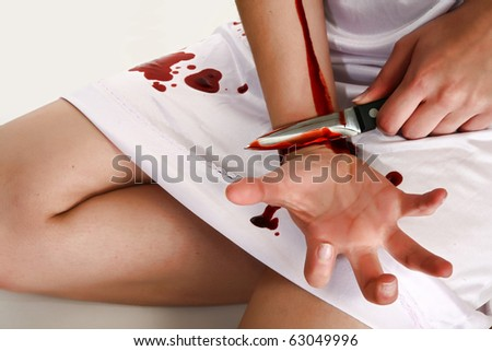 Woman in white cutting self with knife. Self injury.  Cutter. - stock photo
