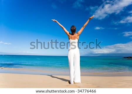 woman in white doing yoga on tropical beach - stock photo