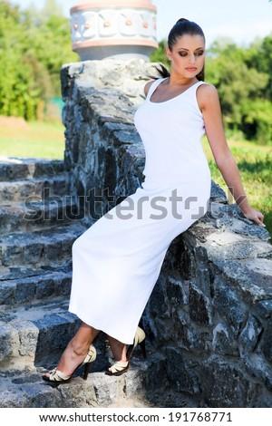 Woman in white dress - stock photo