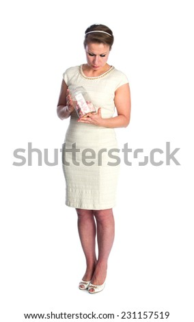 Woman in white dress and bank with candies, isolated - stock photo