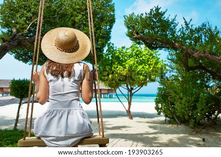 Woman in white dress at tropical beach - stock photo