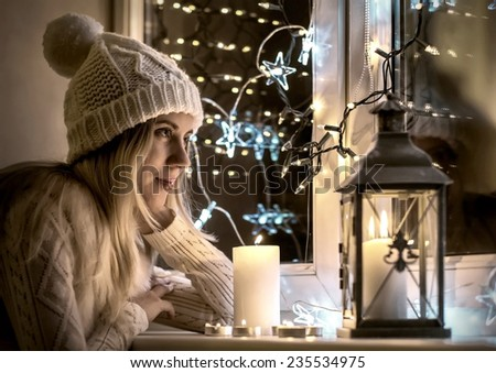 Woman in white hat, Christmas eve and New Year - stock photo