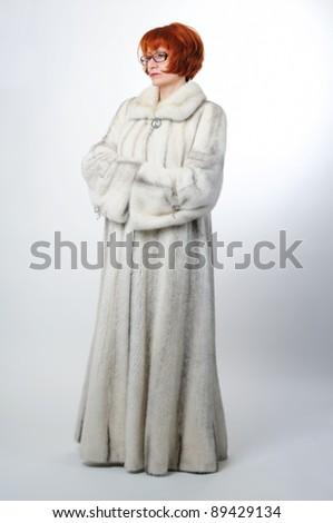 Woman in white mink long fur coat - stock photo