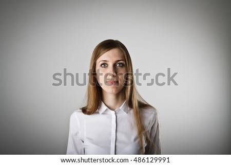Woman in white. Portrait of a young woman. Young woman is doing something.
