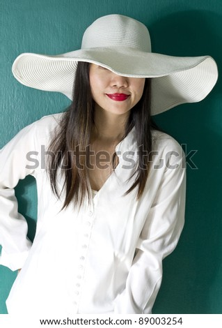 woman in white shirt on green background - stock photo