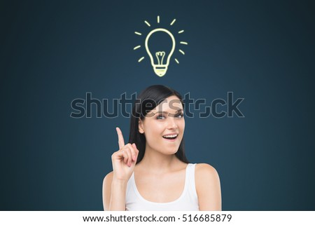 Woman in white tank top is standing in room with dark blue wall. A light bulb sketch is floating above her head. Concept of a brilliant idea