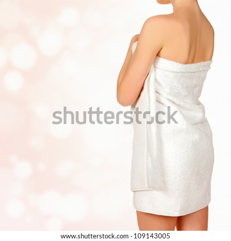 Woman in white towel, abstract background with circles and copyspace - stock photo