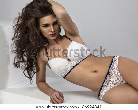 Woman in white underwear posing - stock photo