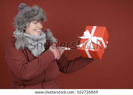Woman in winter clothes and christmas presents - stock photo
