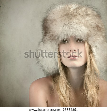 woman in winter clothes on grunge background - stock photo