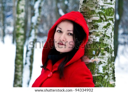 Woman in winter forest - stock photo