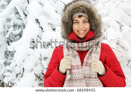 Woman in winter forest close up - stock photo