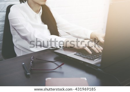 woman in working table in brick wall  background - stock photo