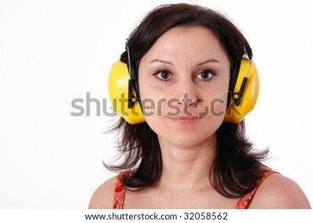 woman in yellow protective receivers - stock photo